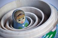 65211321 - the smallest of the matrioska russian dolls, inside the others